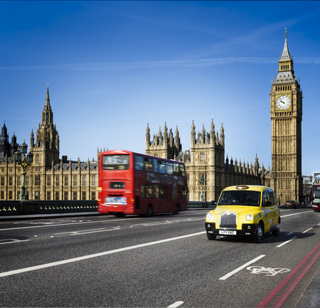 8 12: LONDON - APRIL 12, 2015 : London Buses and traditional taxi with Big Ben on April 12, 2015 in London, England. The London Bus service is one of the largest urban bus networks in the world with 8,000 buses covering 700 routes.
