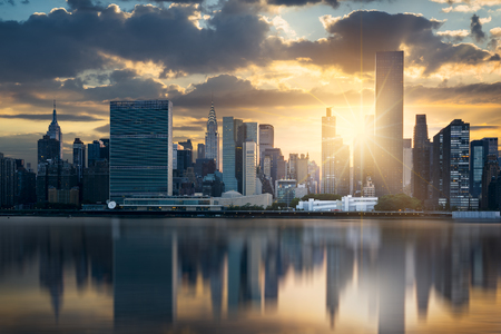 sunset city: New York City skyline with urban skyscrapers at sunset, USA. Stock Photo