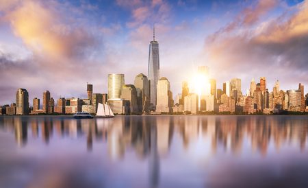 city skyline: New York City skyline with urban skyscrapers at sunset, USA. Stock Photo