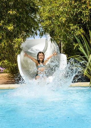 toboggan: Girl is swimming sliding on toboggan at aqua park
