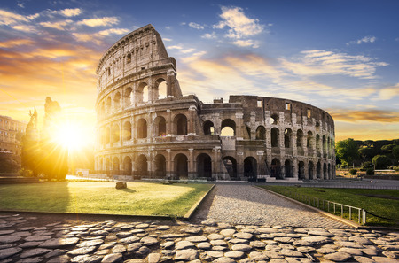 View of Colosseum in Rome and morning sun, Italy, Europe. Stock Photo