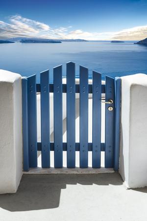 deepness: Blue door and see in Santorini Island, Cyclades Greece Stock Photo