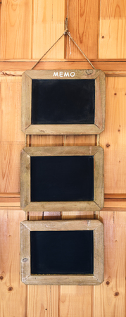 nailed: signs decorative slate nailed to wooden wall