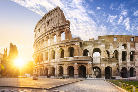 View of Colosseum in Rome and morning sun, Italy, Europe. Archivio Fotografico