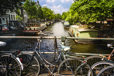 bycicle: Bikes on the bridge in Amsterdam Netherlands