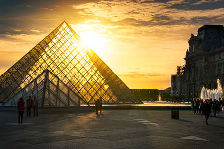 most popular: Paris - June 04, 2017: Louvre museum at dusk on June 04, 2017 in Paris. This is one of the most popular tourist destinations in France displayed over 60,000 square meters of exhibition space Editorial
