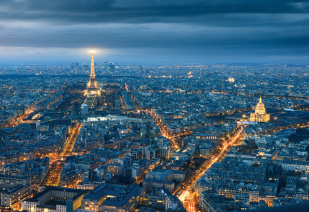 View of the Eiffel tower at night from Tour Montparnasse, Paris.