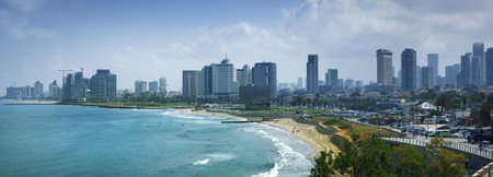 Tel Aviv skyline by day with beach, sea and waves
