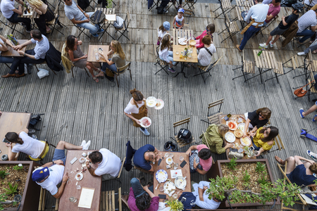 Paris, June 5, 2017 : people is havin lunch in a terrace restaurant, relaxing and friendly moment, style of life. Editorial