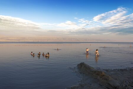 Dead Sea, Israel, May 05, 2017 : Photo of people  floating on surface Dead Sea enjoy summer sun and vacation. Recreation tourism, healthy lifestyle, free time concept Editorial