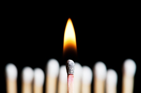 one burning match in front of others in background Stock Photo - 10046953