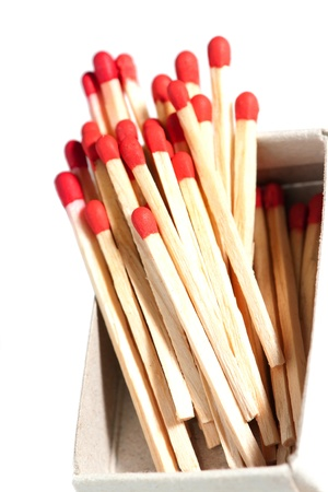box full of matches with red head, isolated on white background