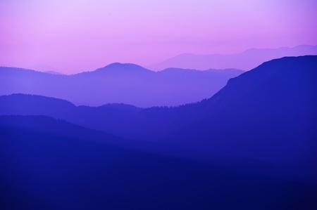 violet sunset in the mountains Stock Photo
