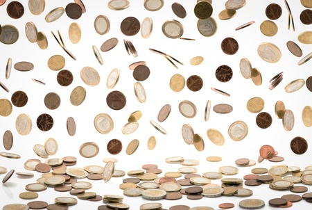 Heap of euro coins falling to the ground, white background photo