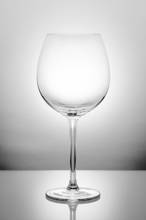 Wine glass with reflection on white background Stock Photo