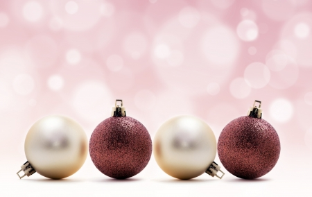 four Christmas balls on pink background Stock Photo