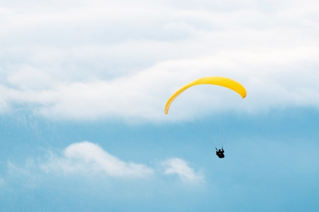 Yellow paraglide on blue sky