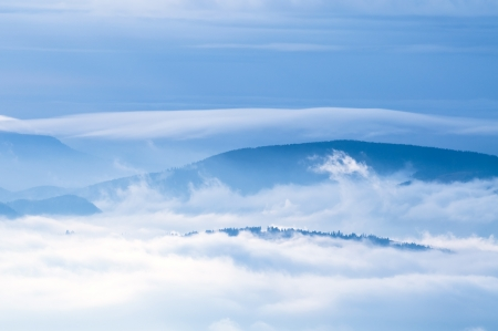 inversion: inversion effect in the moutains  Stock Photo