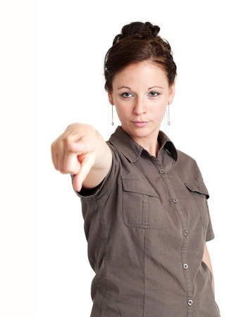 Portrait of young woman pointing her index finger, focus on the face  Isolated over white background Stock Photo