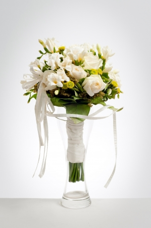 White wedding bouquet in vase on a white background with vignette Stock Photo