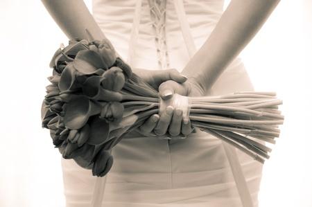 bride with a wedding bouquet - sepia color image