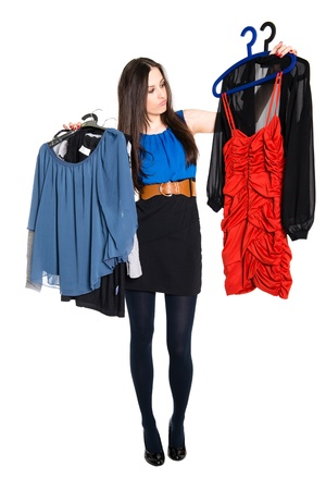 Detail of young woman choosing which dress to wear, isolated on white background