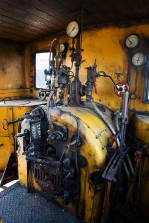 museum rally: Yellow engine room on the steam locomotive Stock Photo