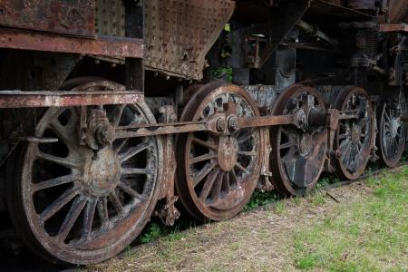 rusty steam locomotive wheels photo