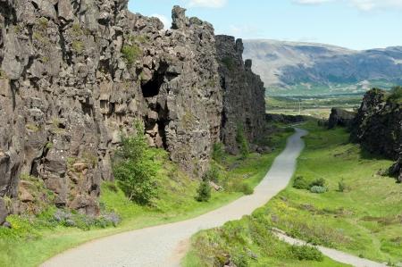 tectonics: path along Canyon Almannagja between the Eurasian and North American tectonic plates, Iceland Stock Photo
