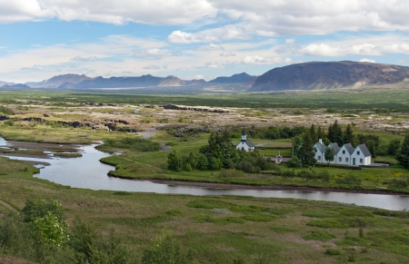 Scenic valley and a village in Thingvellir National park - famous area in Iceland, Iceland