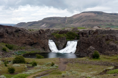 Hjalparfoss waterfall, Iceland photo