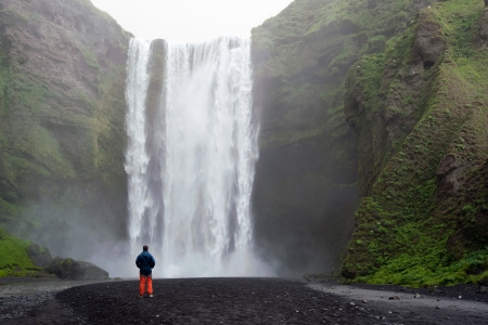 tourist in front of Skogafoss waterfall in Iceland  Stock Photo