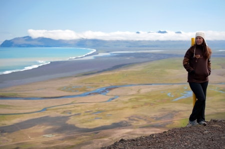 young woman with beautiful Icelandic landscape in the background Stock Photo