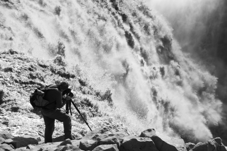 photographer taking picture of largest waterfall in Europe - Dettifoss from close distance, Iceland  black and white picture