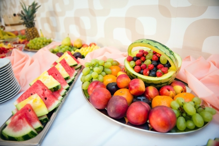 Fruits and berries wedding table decoration photo