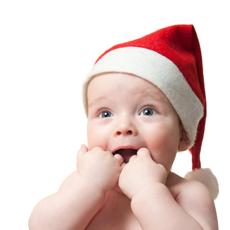 christmas baby: Portrait of cute baby boy in Christmas hat, isolated on white background