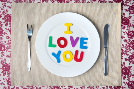 Valentine dinner concept - I LOVE YOU message on a white plate