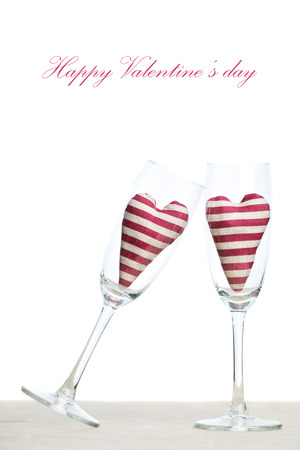 Valentine card - two striped hearts in champagne glasses photo
