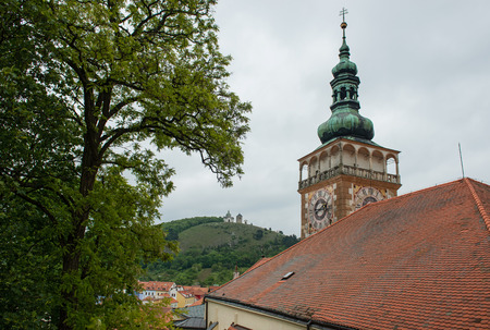 The roof and tower of St Wenceslas and St  Sebastian Chapel on the Holy Hill in background, Mikulov, Czech Republic photo