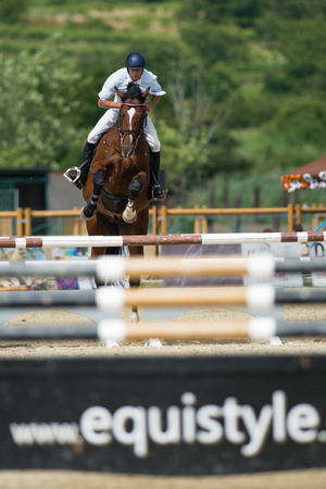 boor: PEZINOK, SLOVAKIA - JULY 29  Boris Boor  SVK  on horse Wild Joker jumps over hurdle on Rozalka Cup 2014 on July 29, 2014 in Pezinok, Slovakia