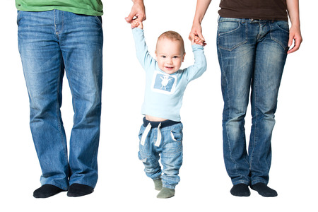 Happy one year old boy holding hands of parents, isolated over white background photo