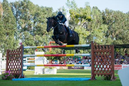 BRATISLAVA, SLOVAKIA - AUGUST 10   Schoonbroodt Celine  BEL  on horse Ace Z jumps over hurdle during Mercedes-Benz Grand Prix Bratislava, Slovakia Editorial