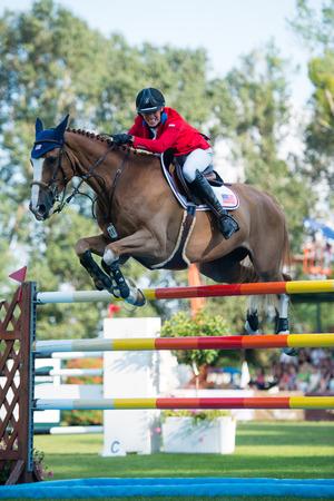BRATISLAVA, SLOVAKIA - AUGUST 10   Porter Wilton  USA  on horse Paloubet jumps over hurdle during Mercedes-Benz Grand Prix Bratislava, Slovakia