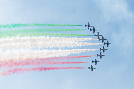 PAYERNE, SWITZERLAND - SEPTEMBER 6: Flight of Italian aerobatic team Frecce Tricolori on AIR14 airshow in Payerne, Switzerland on September 6, 2014