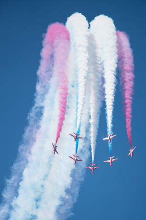 PAYERNE, SWITZERLAND - SEPTEMBER 6: Flight of RAF Red Arrows aerobatic team in close formation on AIR14 airshow in Payerne, Switzerland on September 6, 2014