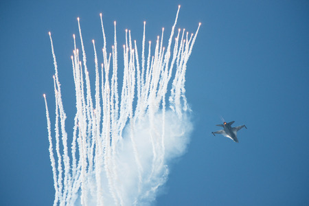 f 16: PAYERNE, SWITZERLAND - SEPTEMBER 6: Falcon of Royal Netherlands Air Force releases flares during demo flight on AIR14 airshow in Payerne, Switzerland on September 6, 2014