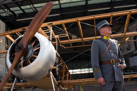 aerobatic: PAYERNE, SWITZERLAND - SEPTEMBER 7: Portrait of man representing Swiss aviation pioneer Oskar Bider with his vintage airplane in background on AIR14 show in Payerne, Switzerland on September 7, 2014