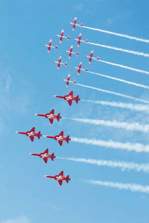 PAYERNE, SWITZERLAND - SEPTEMBER 7: Flight to celebrate 25th and 50th Anniversary of PC-7 and Patrouille Suisse aerobatic teams on AIR14 airshow in Payerne, Switzerland on September 7, 2014