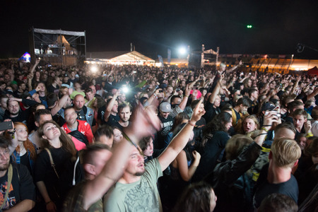 death metal: PIESTANY, SLOVAKIA - JUNE 26: fans support Swedish melodic death metal band Arch Enemy on music festival Topfest in Piestany, Slovakia on July 26, 2015