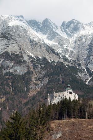 surrounded: Castle Hohenwerfen near Salzburg surrounded by the Berchtesgaden Alps, Austria